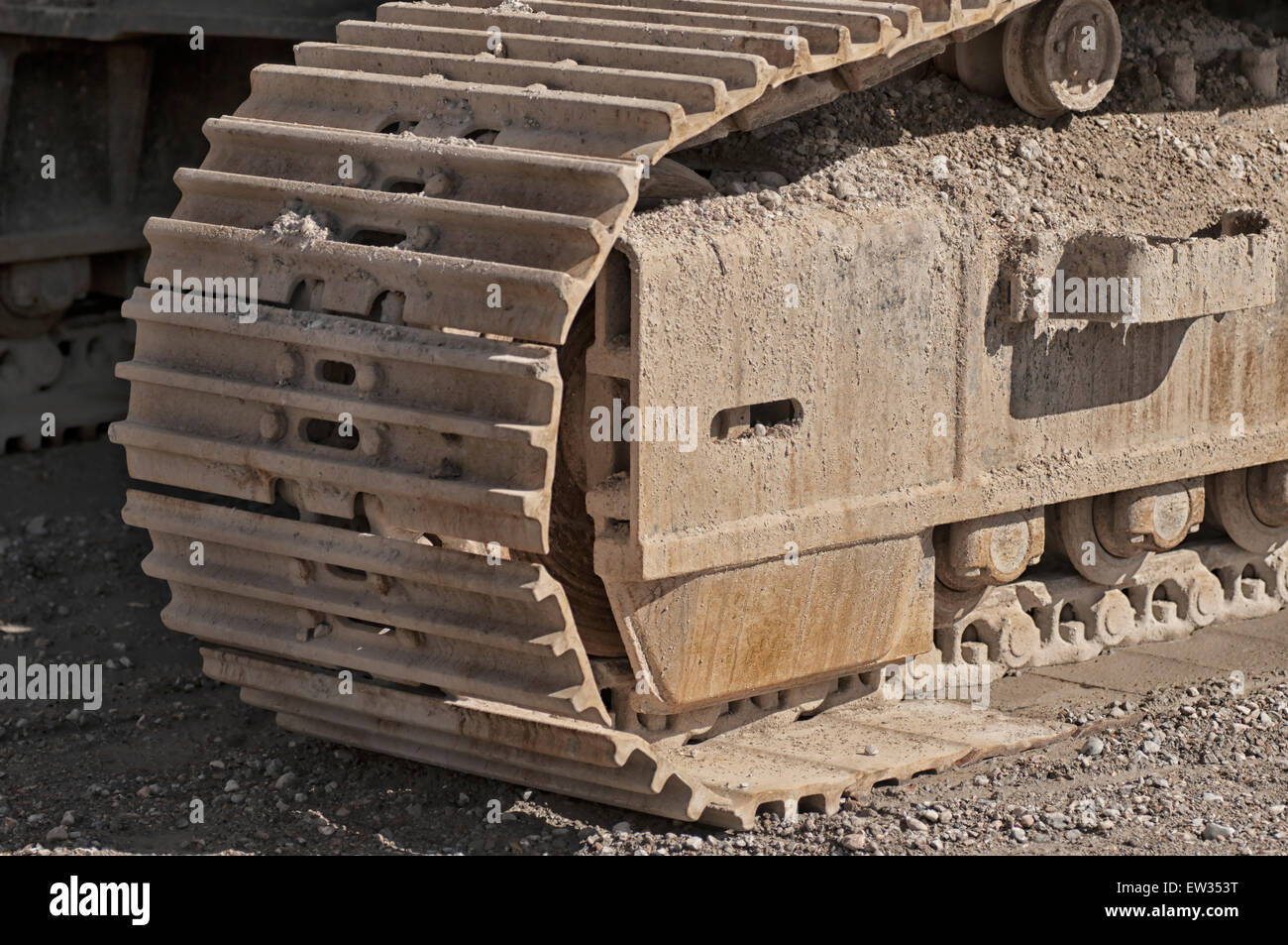 Construction vehicles on a pebbled UK beach - Stock Image