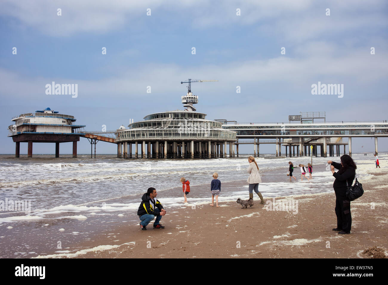 People on Scheveningen beach and pier by the North Sea in The Hague (Den Haag), South Holland, the Netherlands. Stock Photo