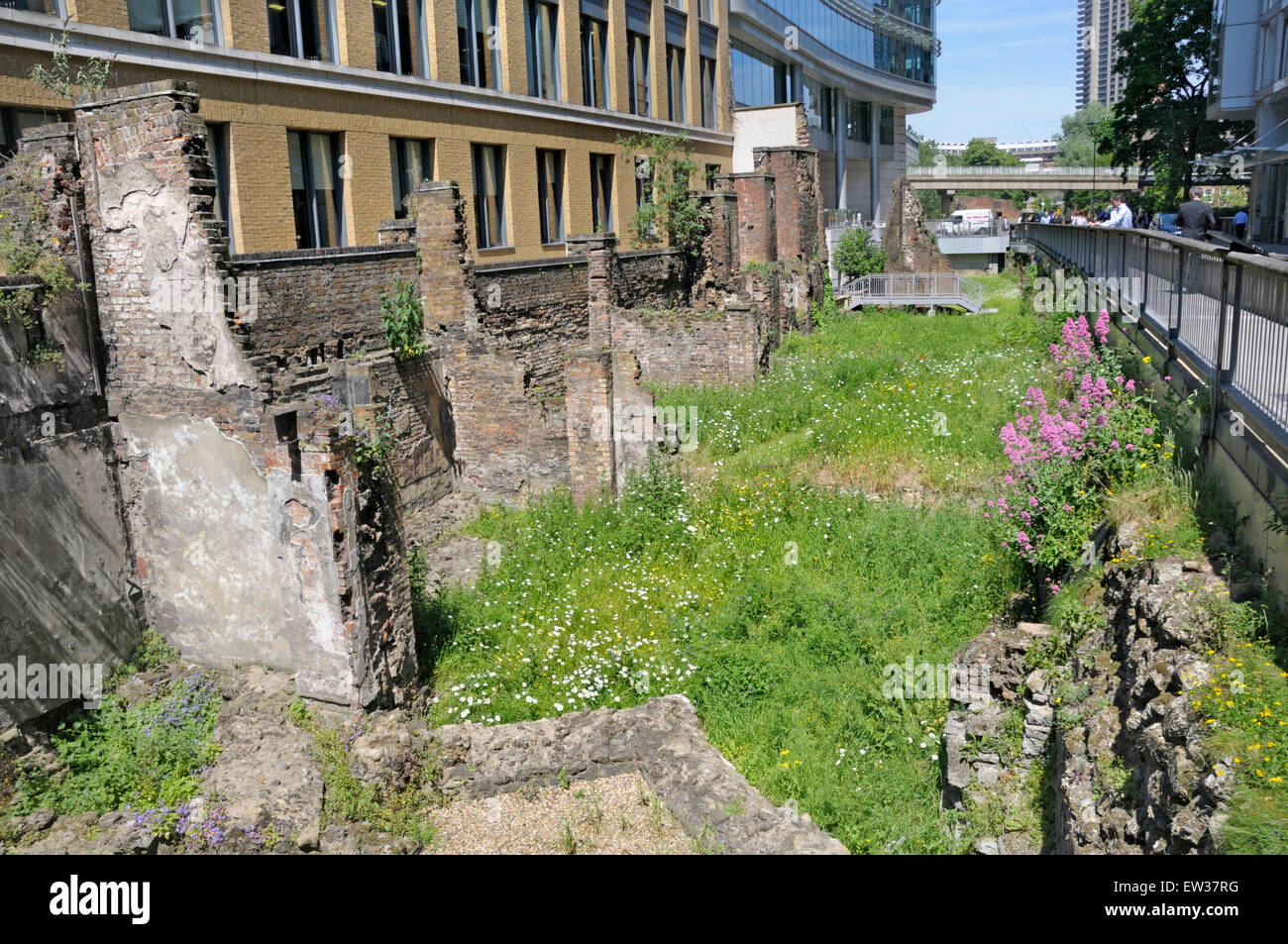 London, England, UK. Surviving section of the original Roman London Wall, by Noble Street, near the Barbican. - Stock Image