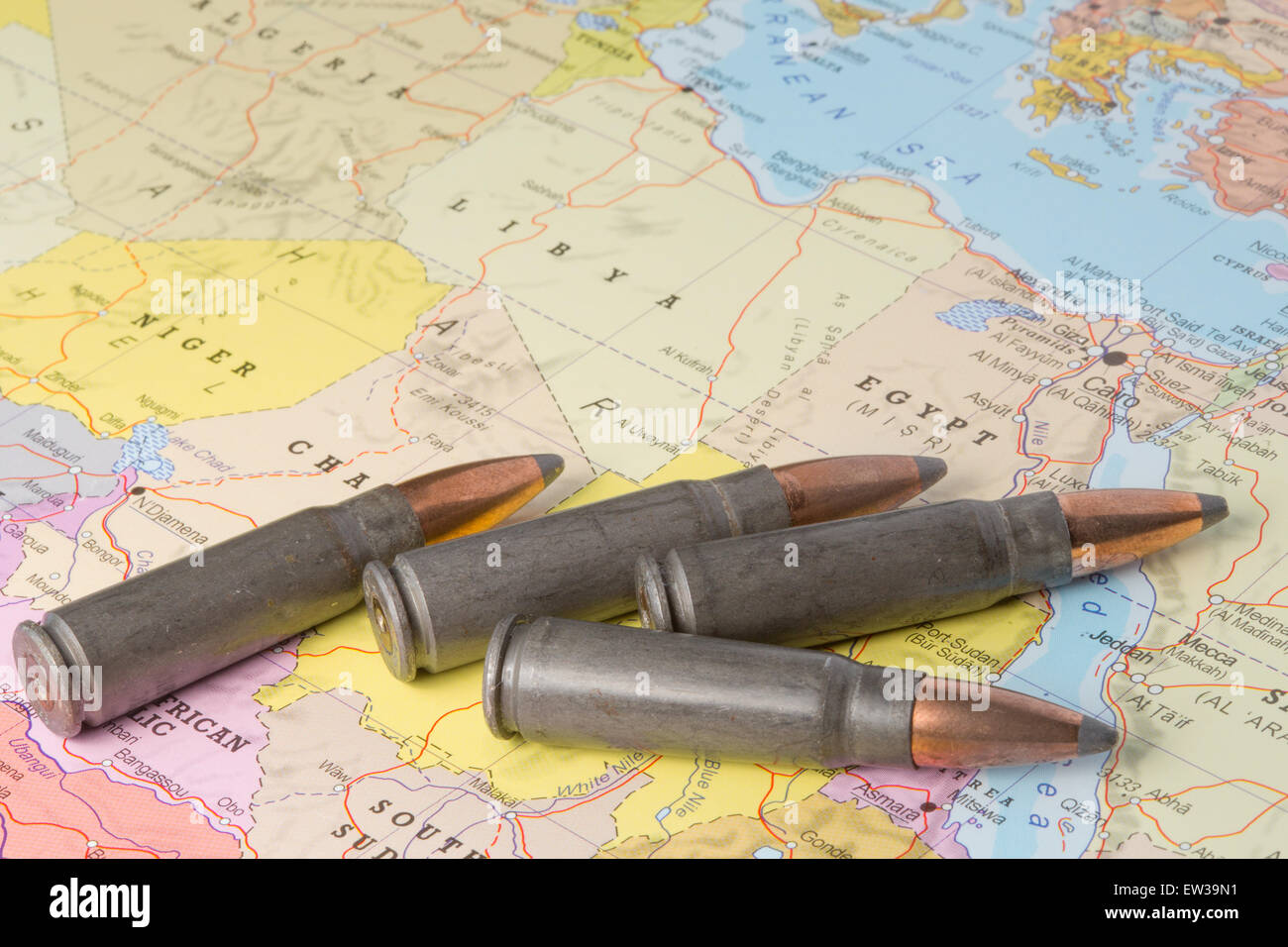 Four bullets on the geographical map of Egypt, Lybia, Algeria and Niger in North Africa. Conceptual image for war, - Stock Image
