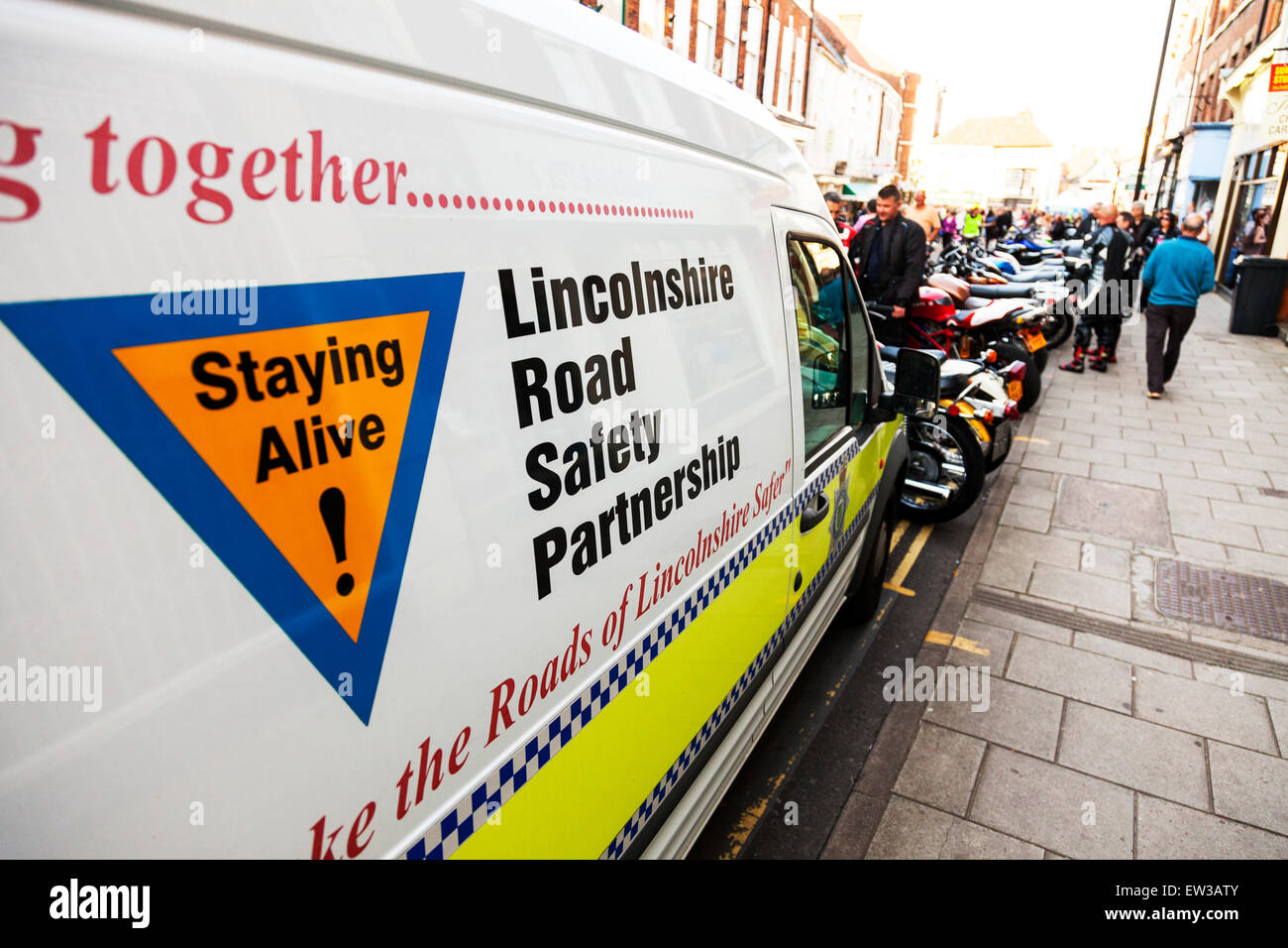 Lincolnshire road safety partnership sign on van staying alive on roads streets police vehicle car - Stock Image