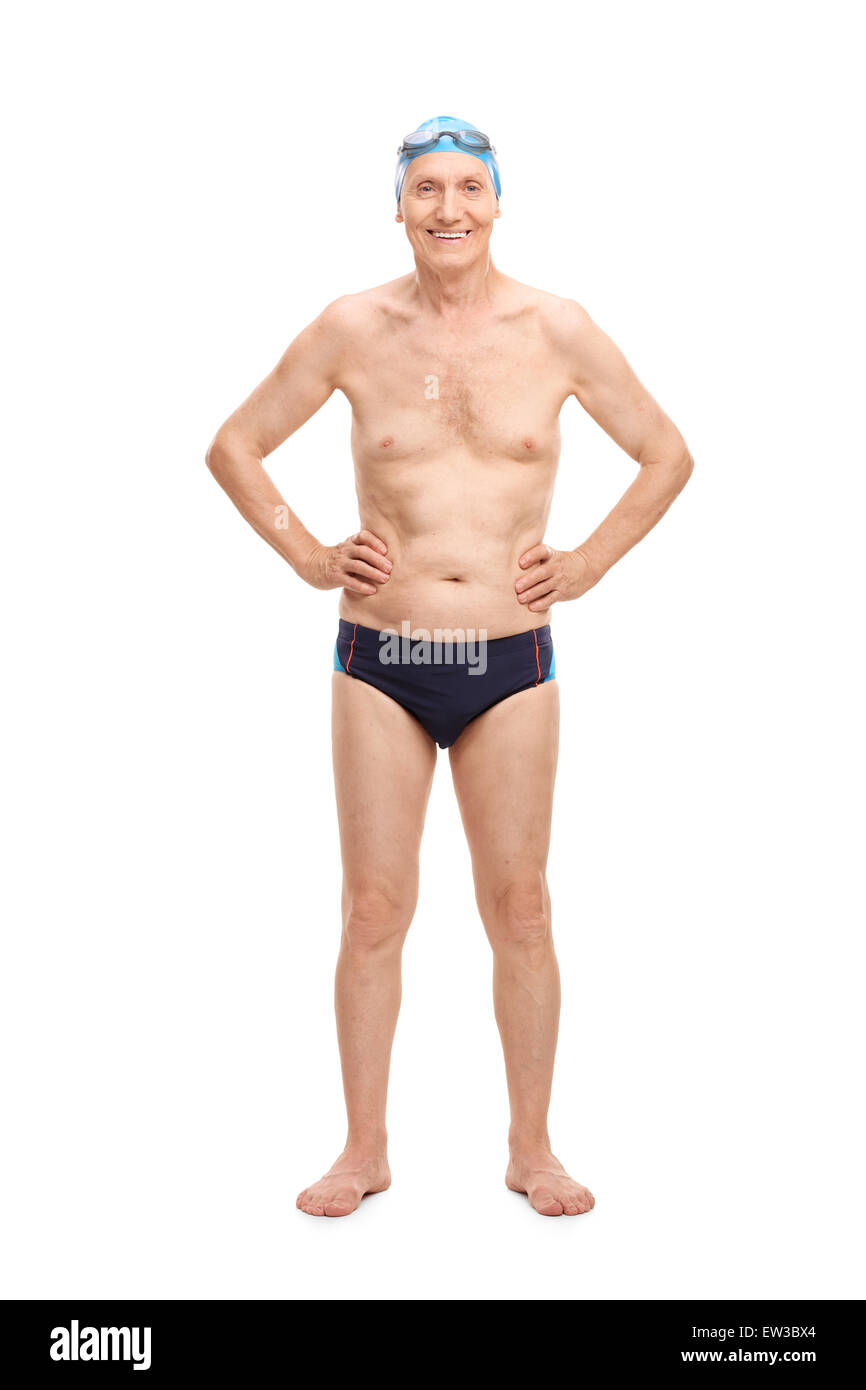 Full length portrait of a shirtless senior in black swim trunks and blue swimming cap looking at the camera and - Stock Image