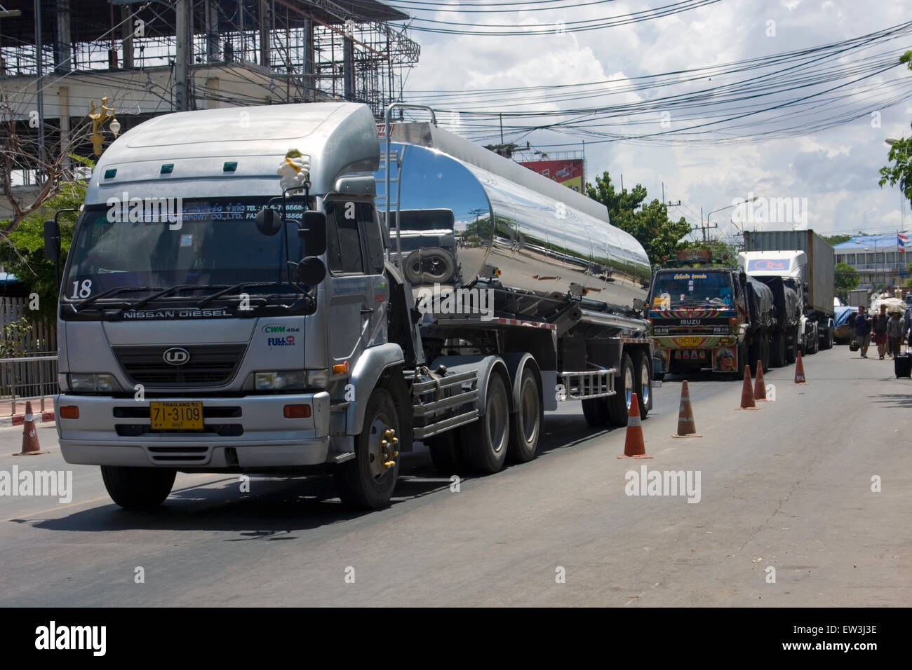 Trucks carrying cargo, including fuel, arrive at the