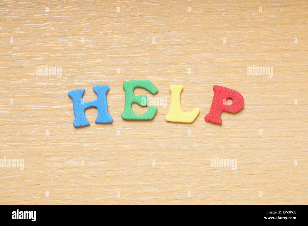 help in foam rubber letters - Stock Image