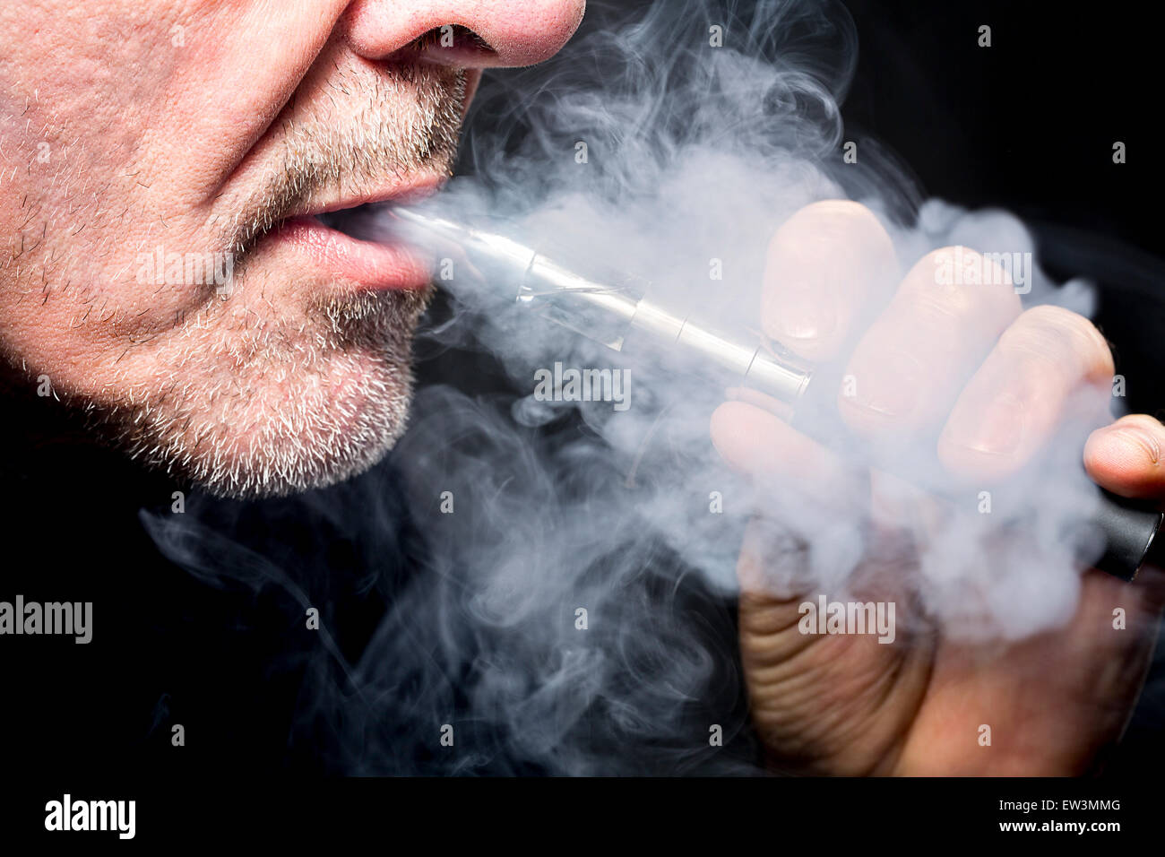 close up portrait of a man smoking an e-cigarette - Stock Image