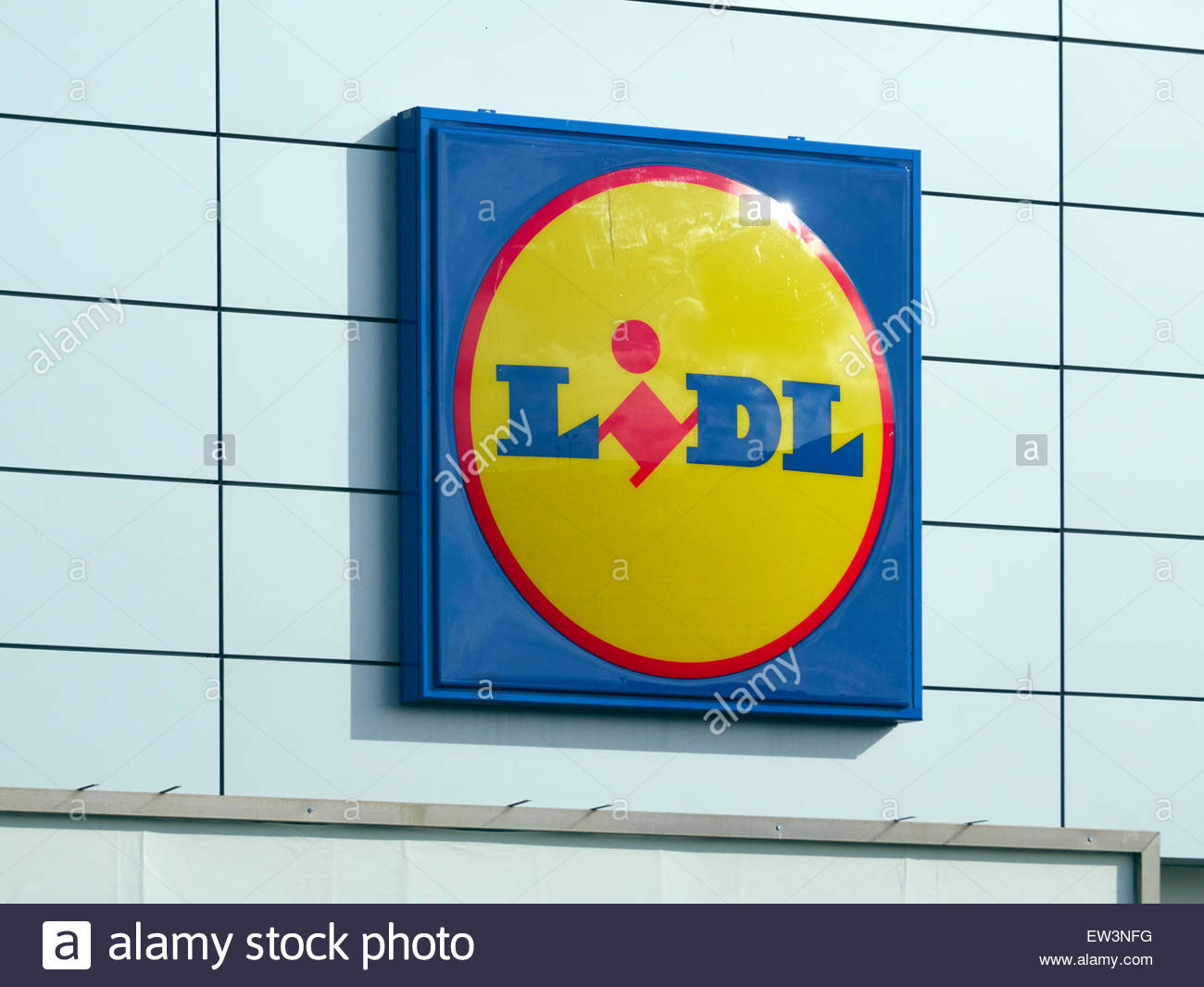 the blue red and yellow sign of the Lidl supermarket logo - Stock Image