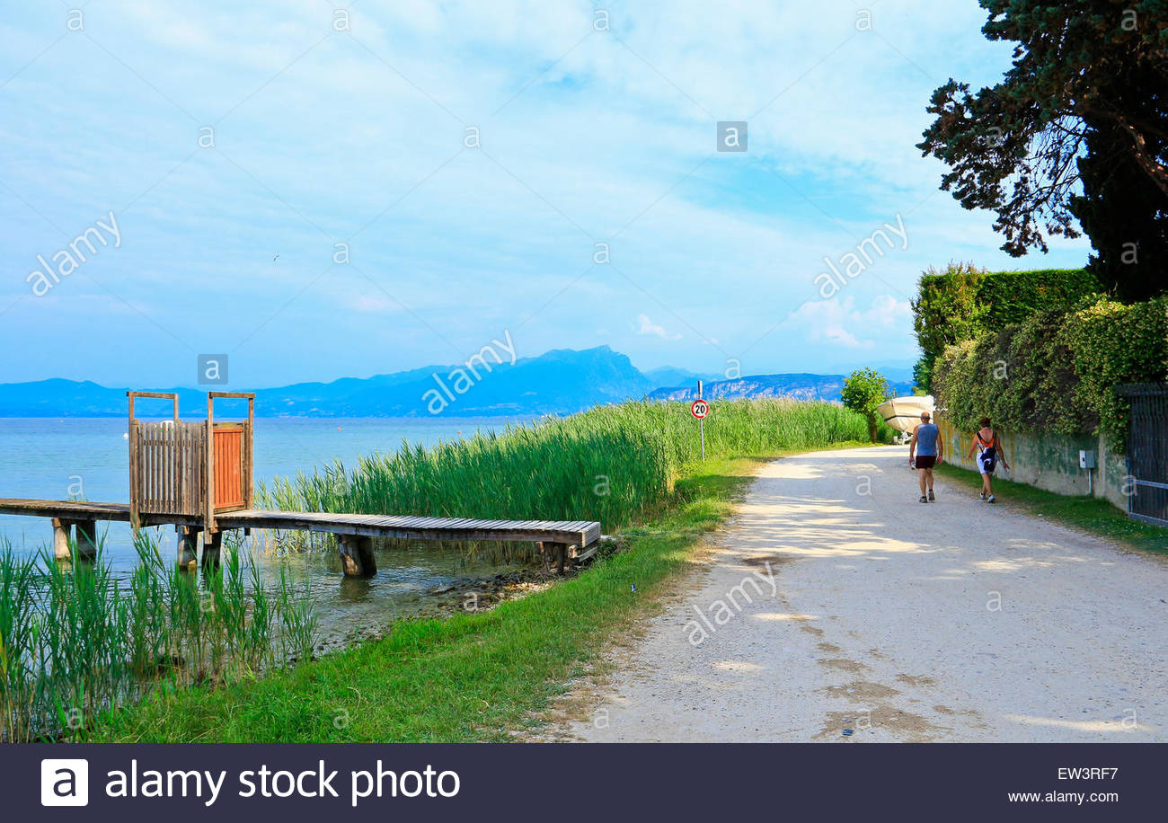 Pathway Lazise to Cisano Lake Garda . Couple walking. Veneto Italy - Stock Image & Garda To Bardolino Route Stock Photos u0026 Garda To Bardolino Route ...