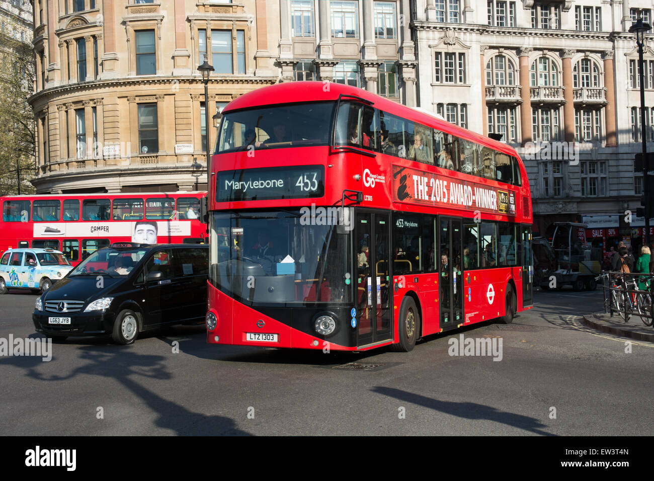 A new bus for London Routemaster passes through Charing Cross on route 453 to Marylebone - Stock Image