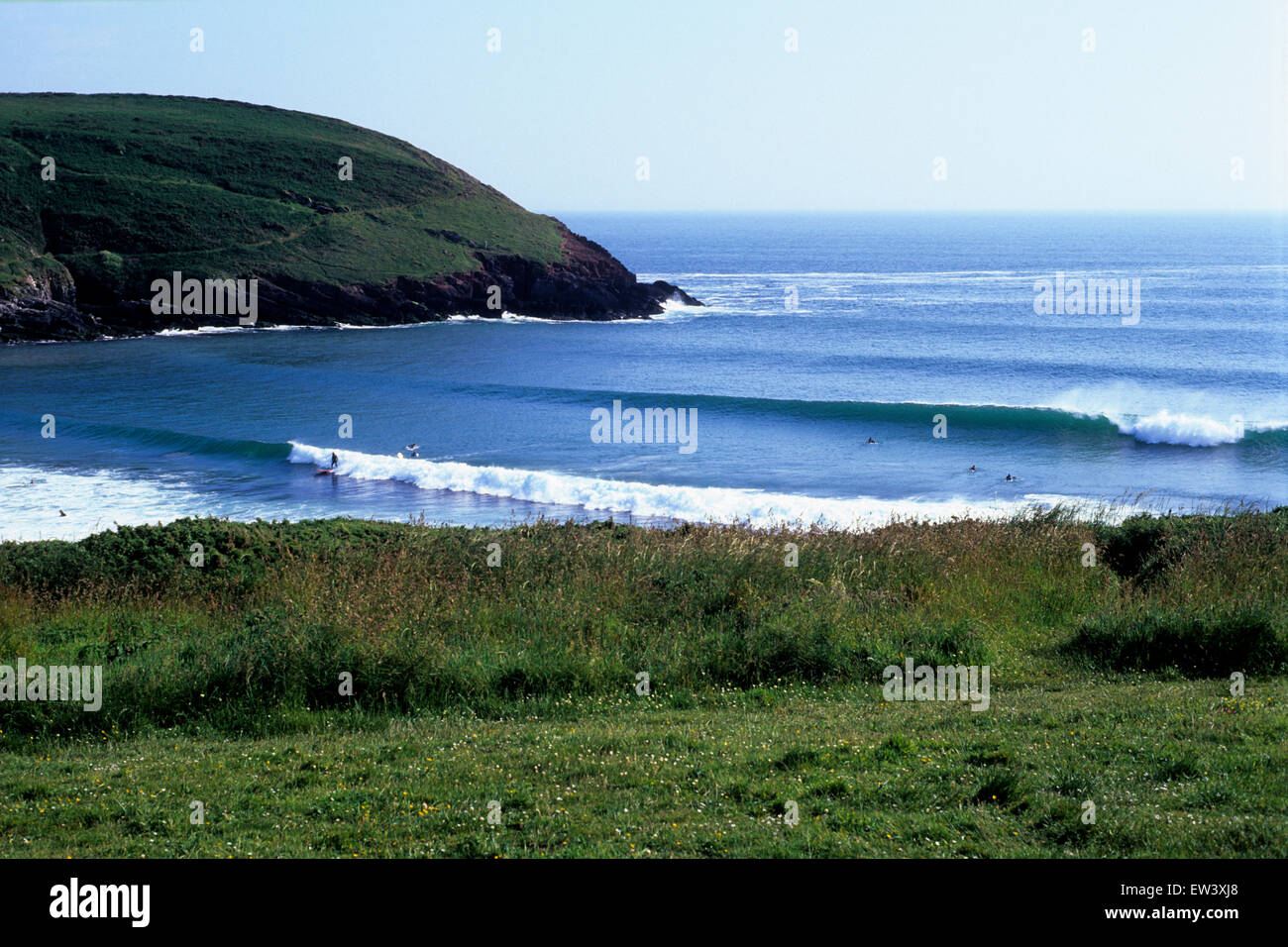 Sheltered from the wind but facing the Atlantic  swells perfect surfing waves peel into the bay at  Manorbier, west - Stock Image