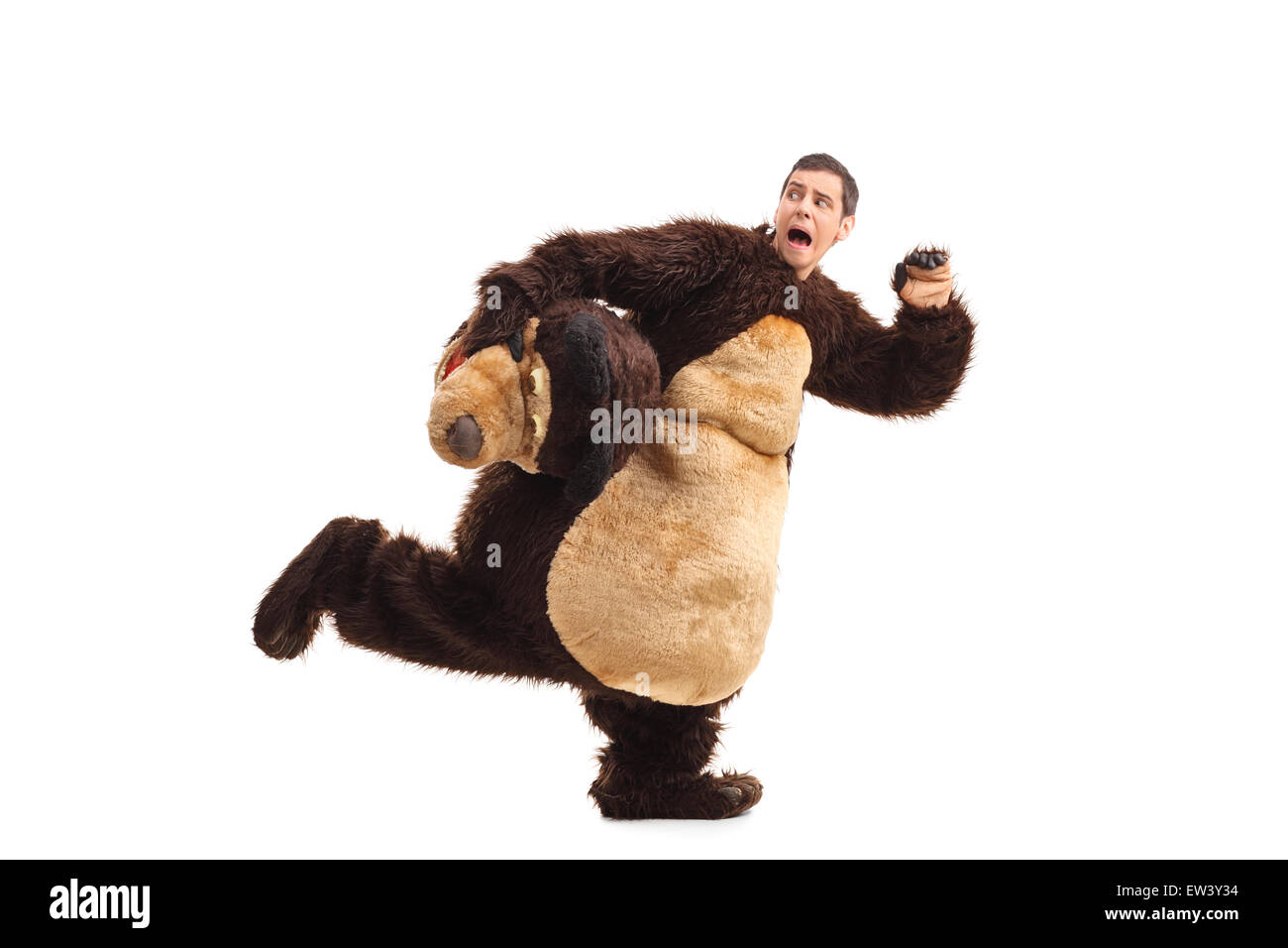 Terrified young man in a bear costume running away from something isolated on white background Stock Photo