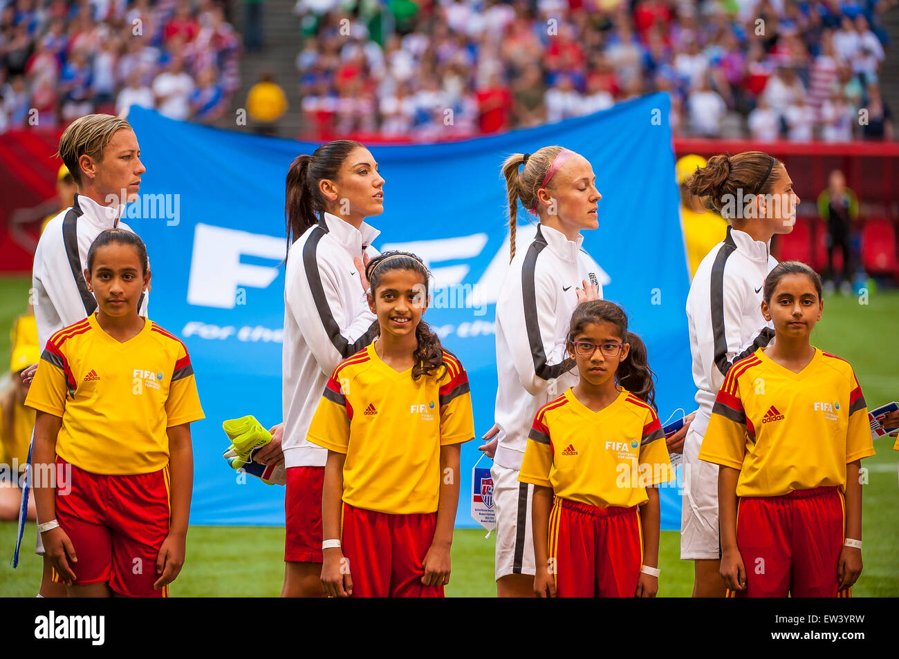 Vancouver, Canada. 16th June, 2015. Team United States during the national anthem ahead of their opening round match - Stock Image