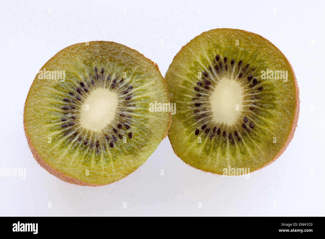Ripe juicy kiwi on a white background - Stock Image