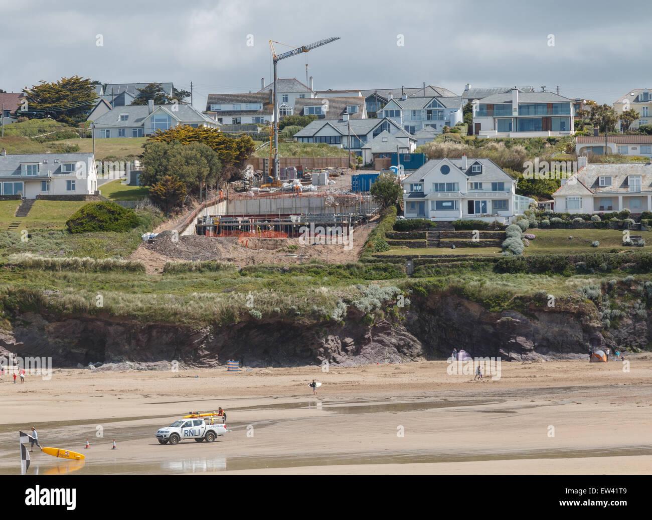 Property development on the coast at Polzeath on the north coast of Cornwall, UK - Stock Image