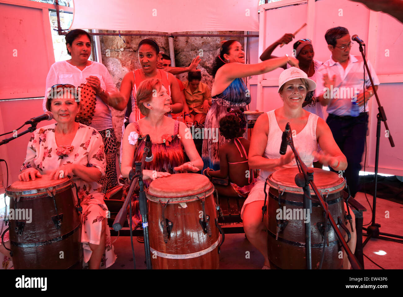 Tourists joining Cuban local residents, partying and performing in a cafe bar in Caibarien, Cuba - Stock Image