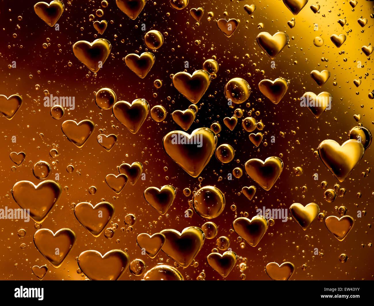 Orange air bubbles shaped like hearts - Stock Image