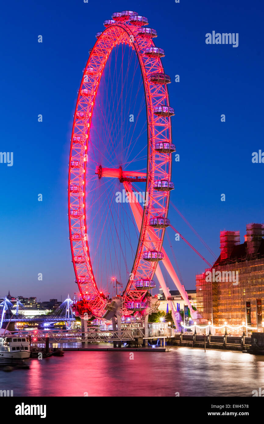 The London Eye is a giant Ferris wheel on the South Bank of the River Thames in London. Also known as the Millennium - Stock Image