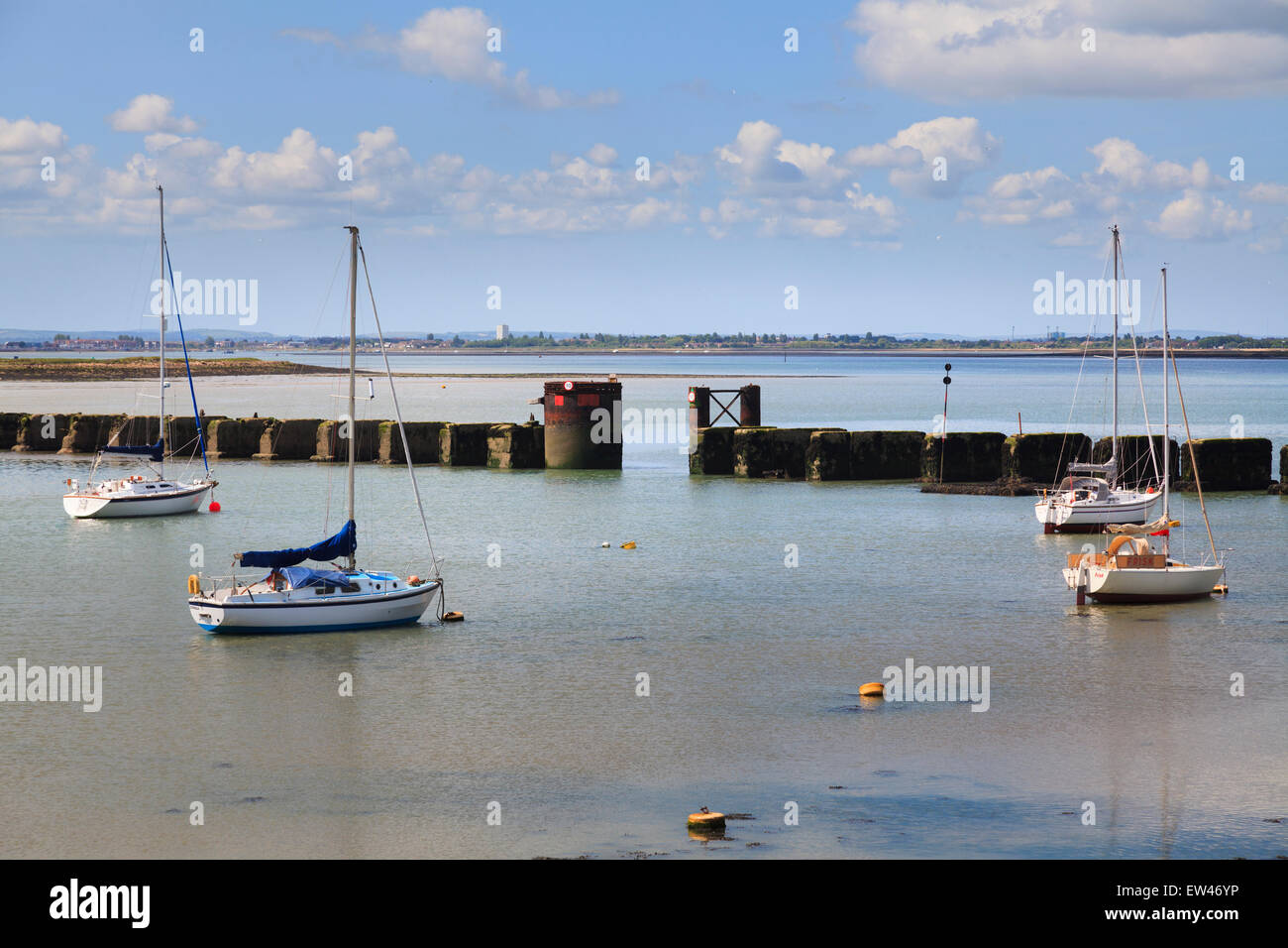 Boat access gap in the supports for the old Hayling Billy Bridge across Langstone Harbour Stock Photo