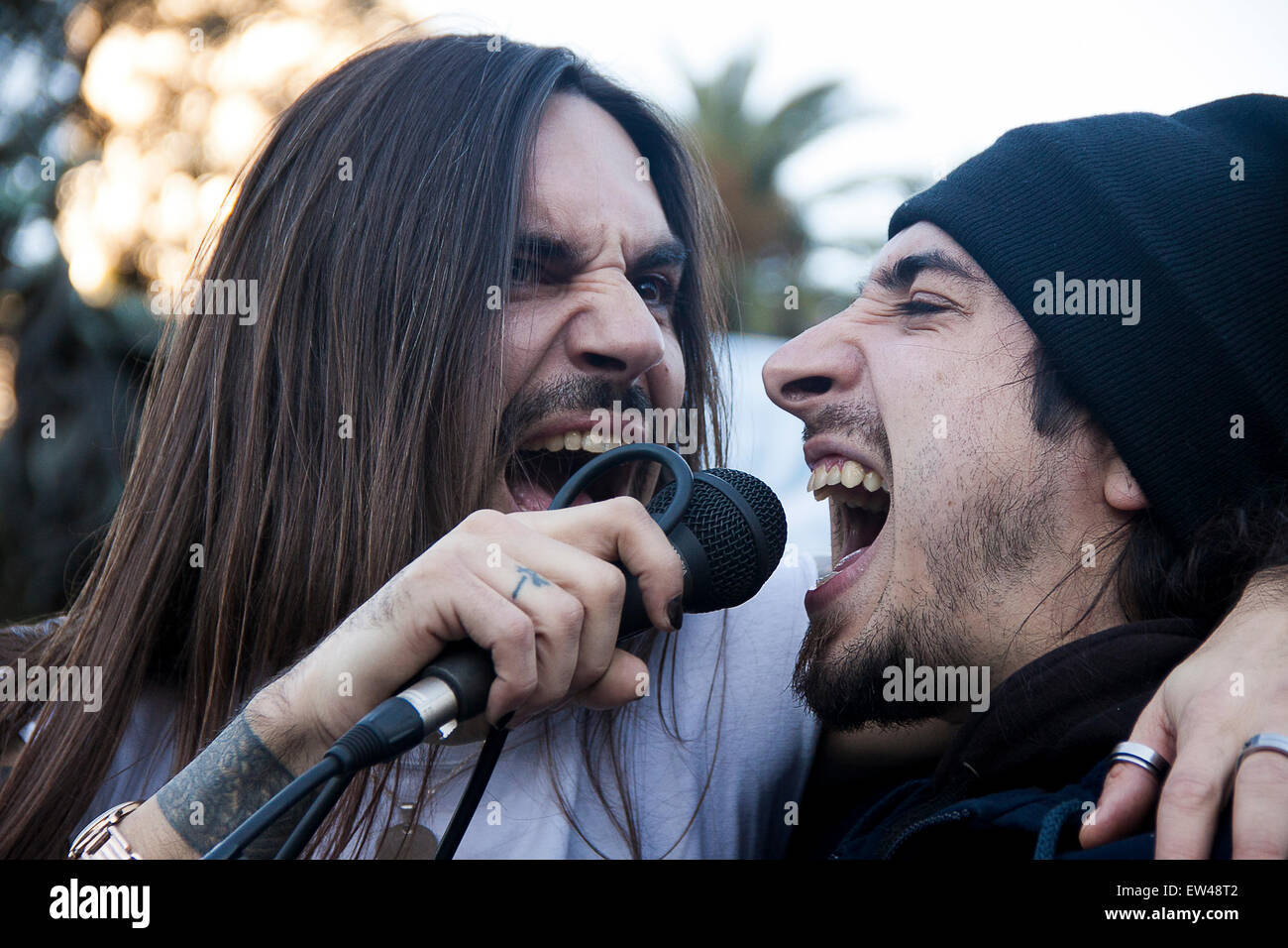 Signer rock and roll. angry rock Signer. Close-up. Grimace. grimacing with anger. Two  singers rock. scream. microphone - Stock Image