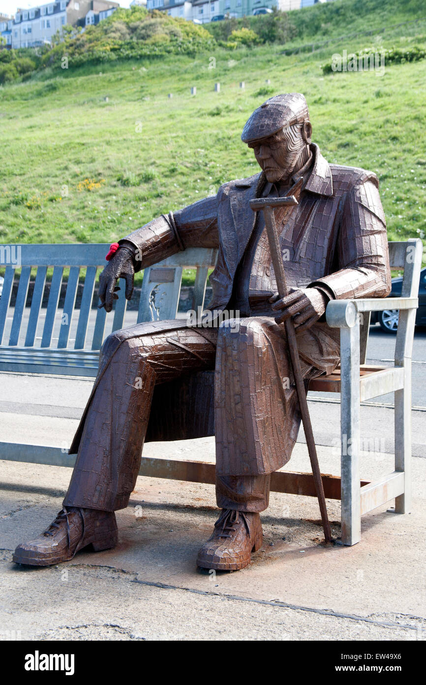 Freddie Gilroy and the Belsen Stragglers sculpture overlooking North Bay, Scarborough, Yorkshire, UK - Stock Image