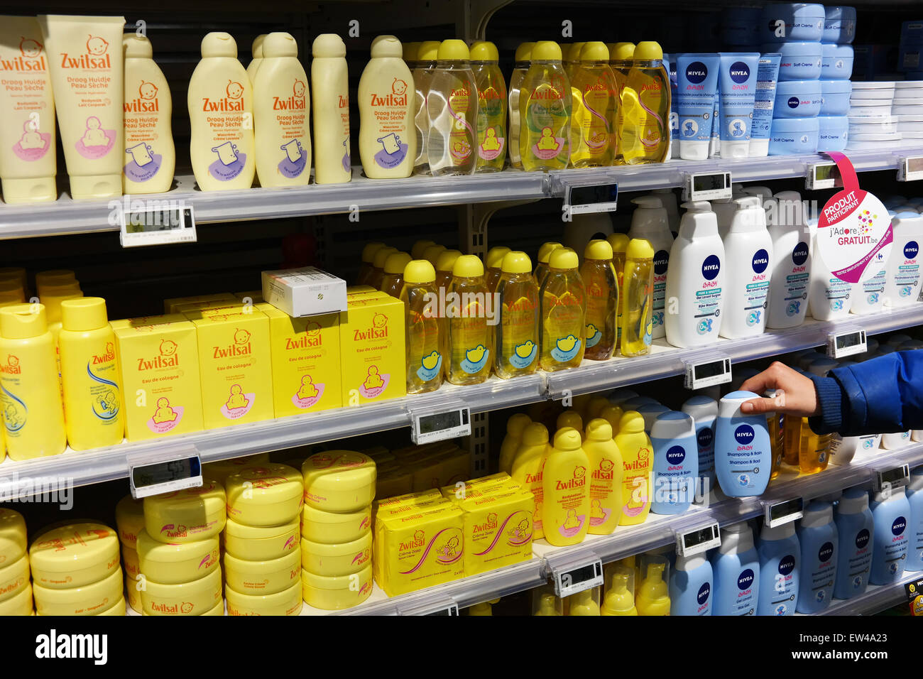 MALMEDY, BELGIUM - MAY 2015: Aisle with a variety of baby care products in a Carrefour Hypermarket. - Stock Image