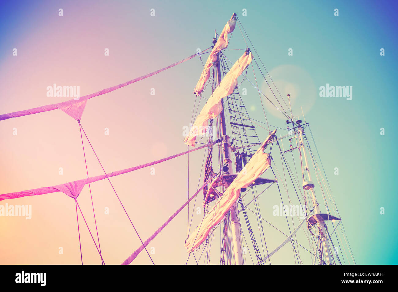 Vintage retro instagram style picture of a sailing ship mast with lens flare effect. - Stock Image
