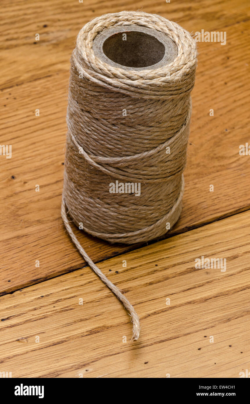 Ball of string on an oak top - Stock Image