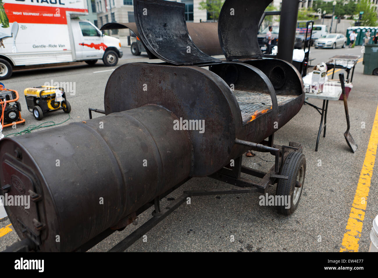 Large drum charcoal grill - USA - Stock Image