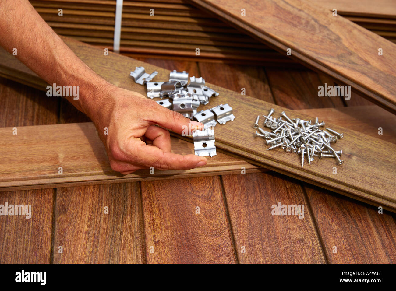 Ipe decking deck wood installation screws clips and fasteners - Stock Image