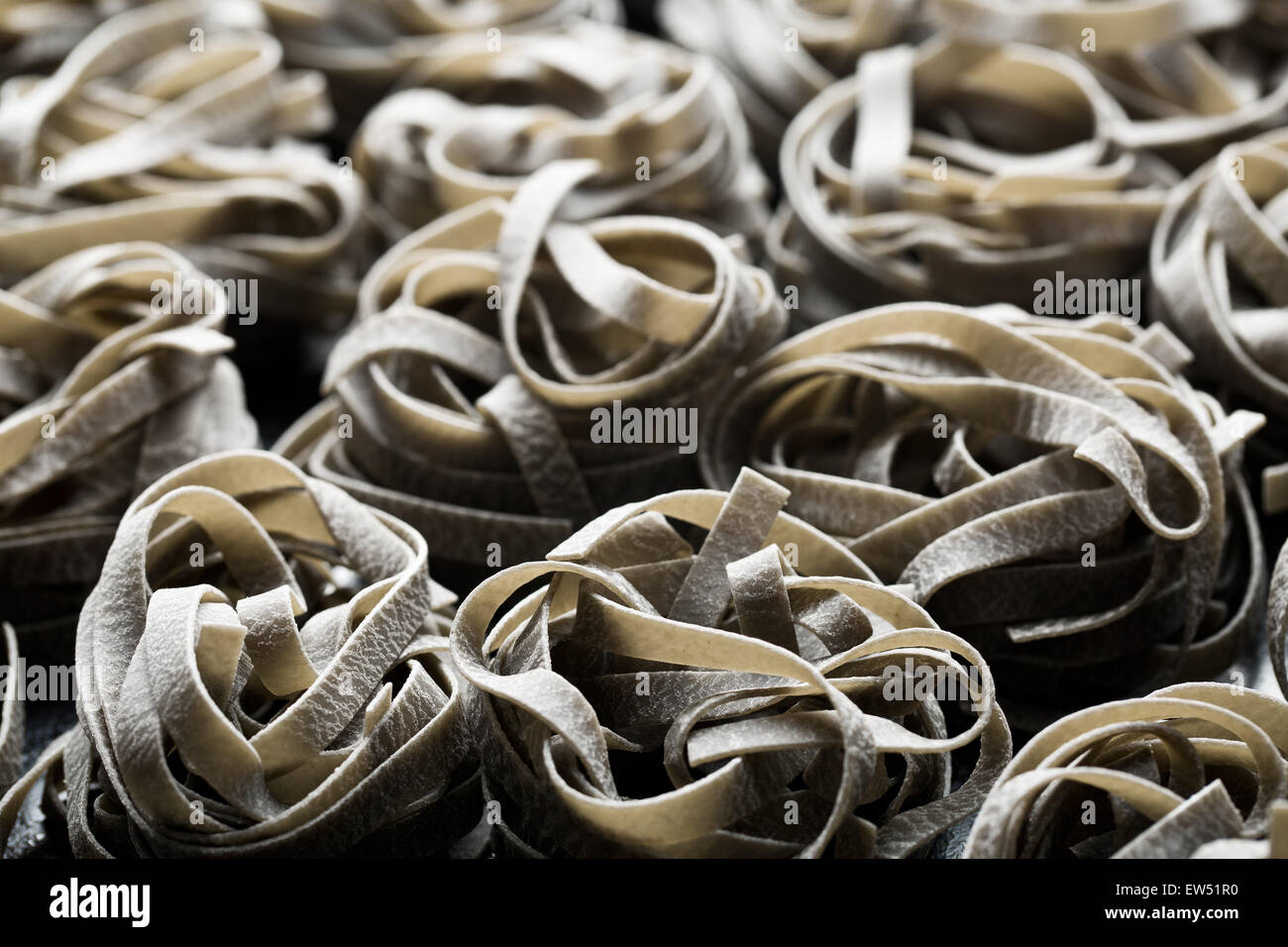 a lot of  black tagliatelle pasta - Stock Image