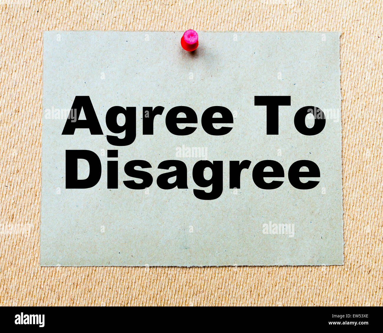 Agree To Disagree written on paper note pinned with red thumbtack on wooden board. Business conceptual Image - Stock Image