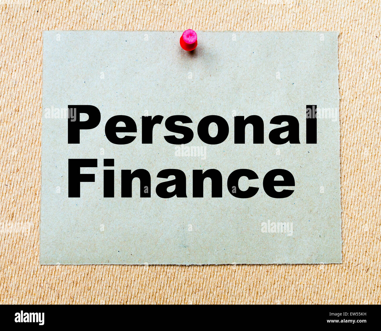 Personal Finance written on paper note pinned with red thumbtack on wooden board. Business conceptual Image - Stock Image