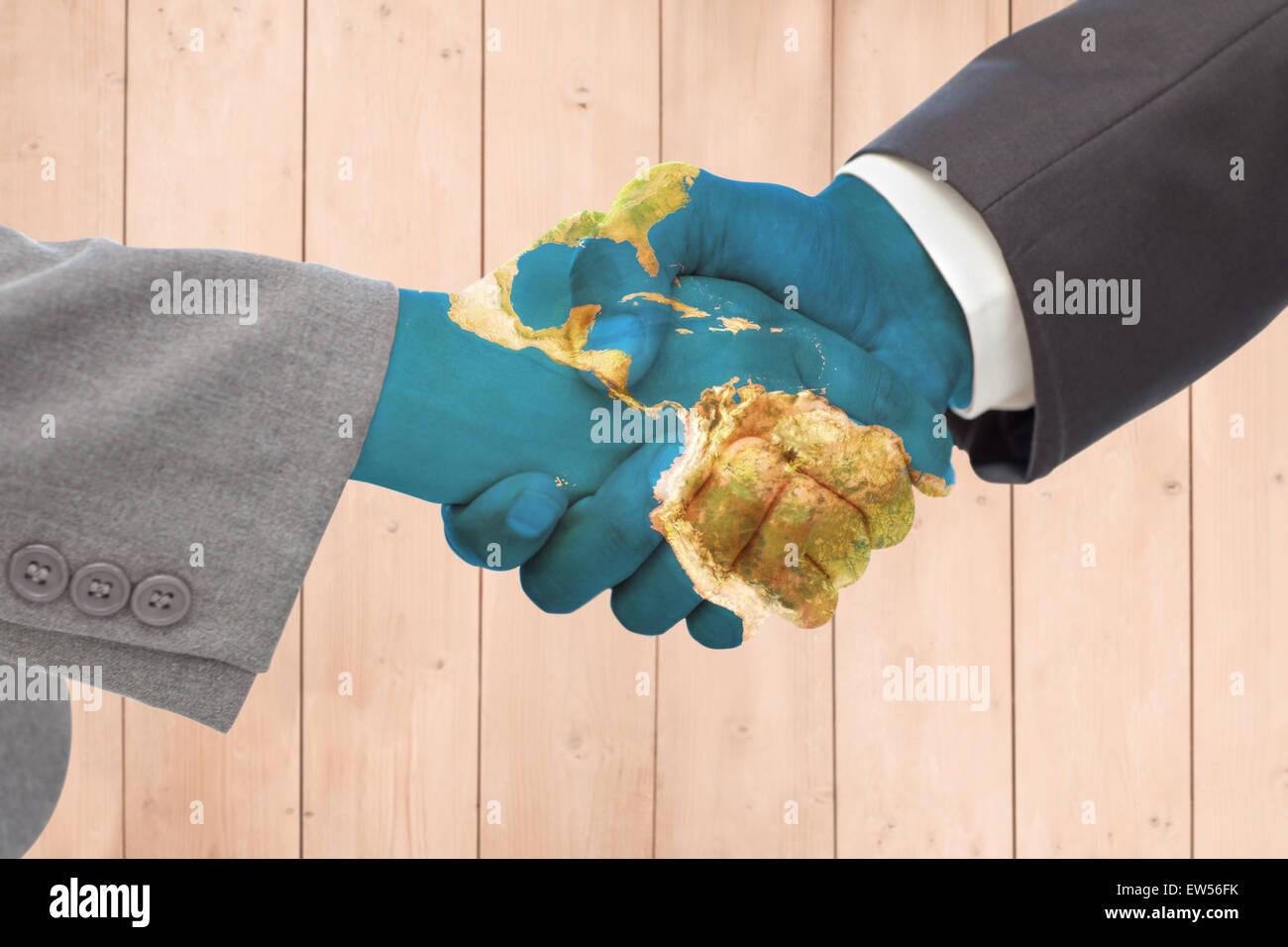 Composite image of handshake between two business people - Stock Image