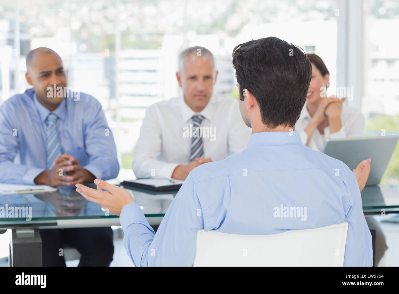 Businessman at work interview - Stock Image