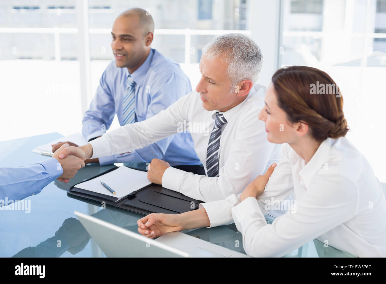 Businessman shaking hand during work interview - Stock Image