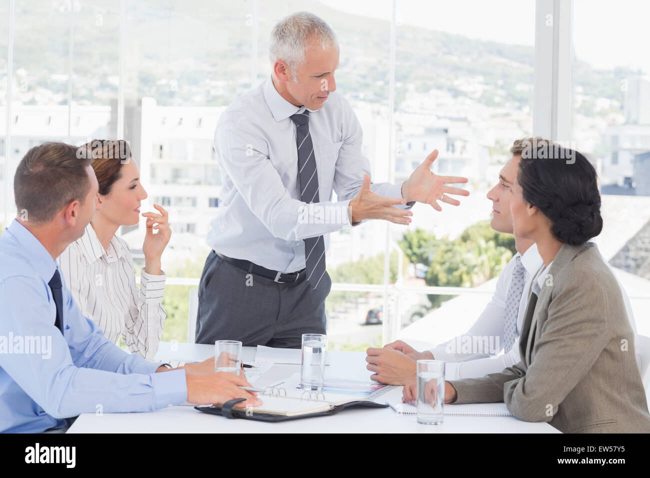 Businessman yelling at his team - Stock Image