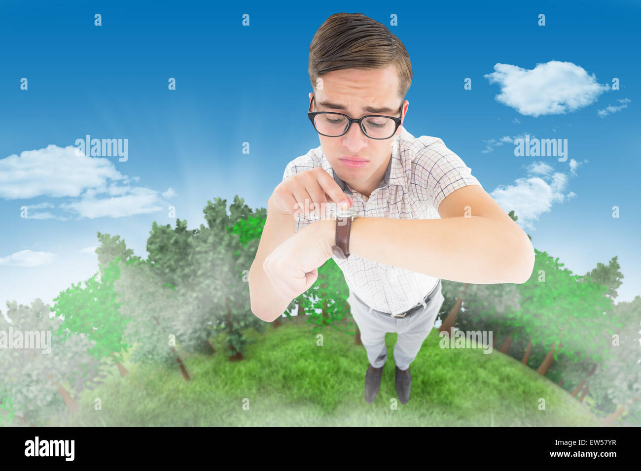 Composite image of geeky hipster pointing to his watch - Stock Image