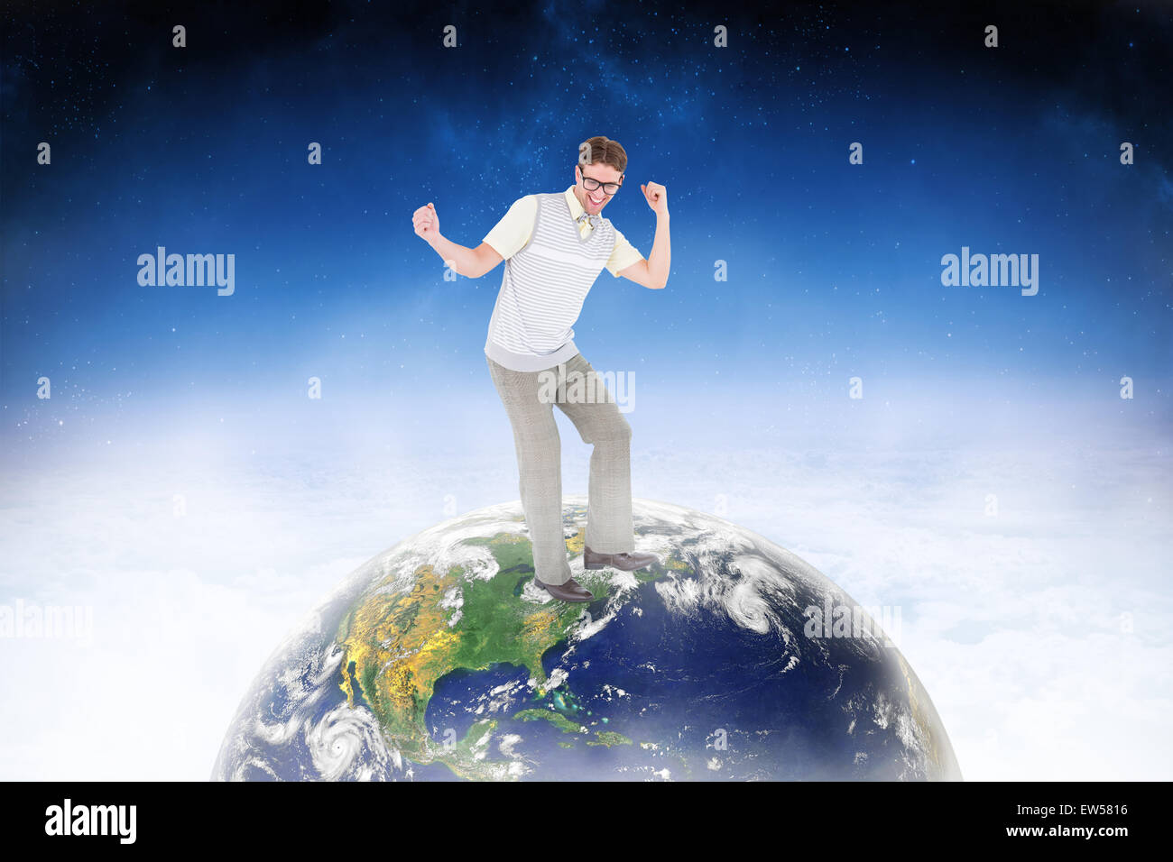 Composite image of geeky hipster dancing and smiling - Stock Image