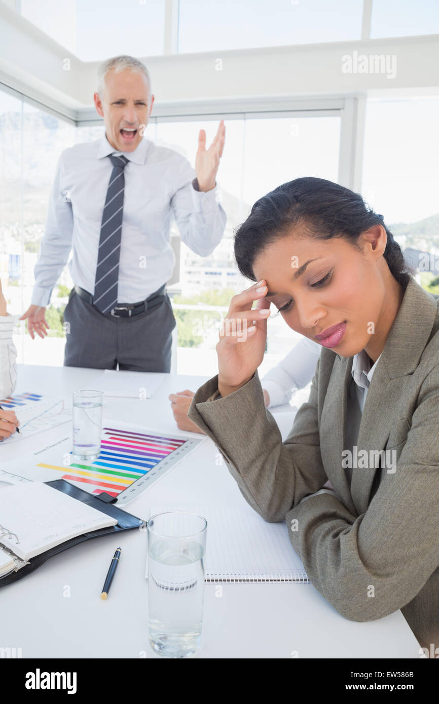 Businessman yelling at his colleague - Stock Image