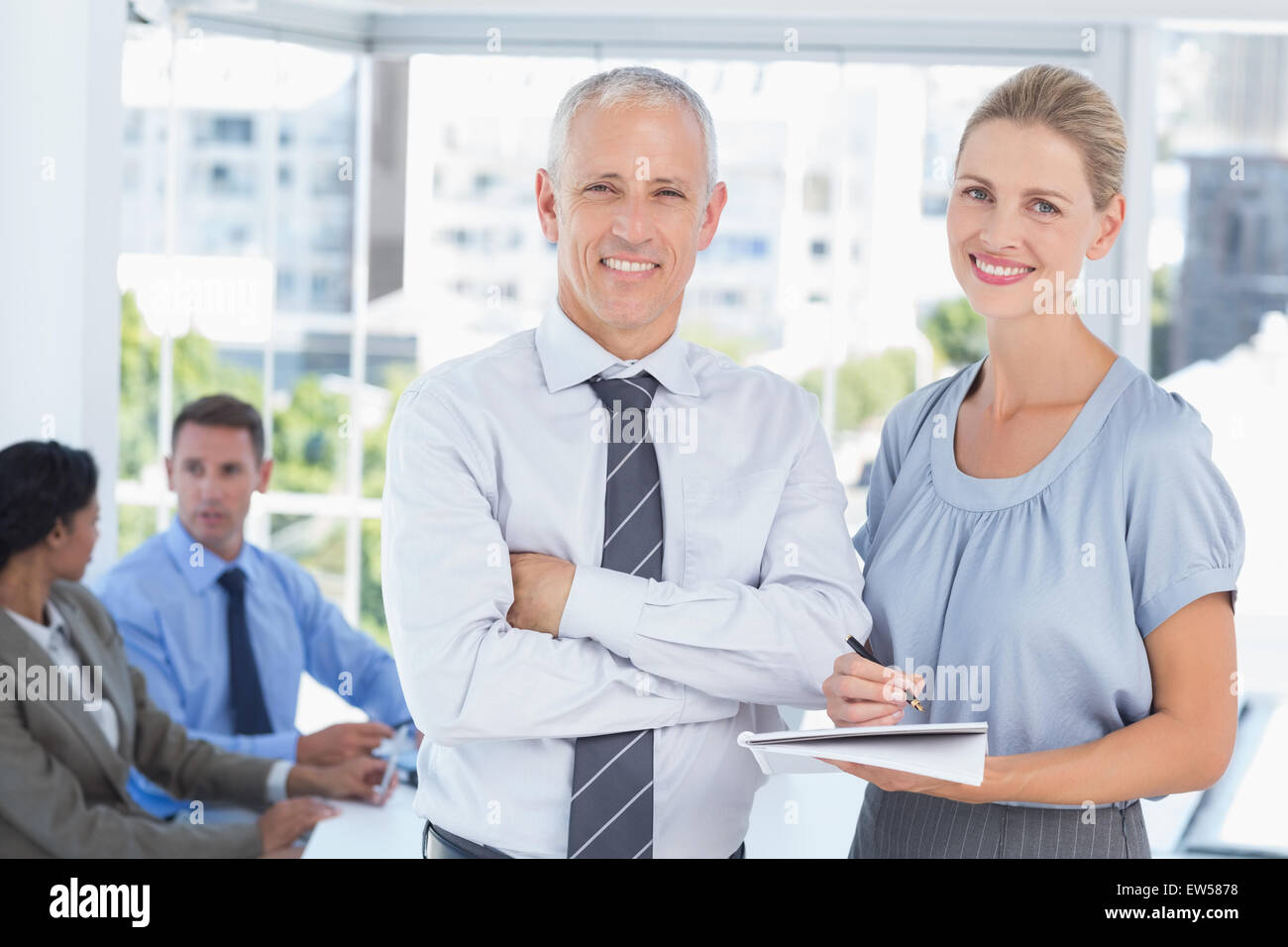 Colleagues speaking about work - Stock Image