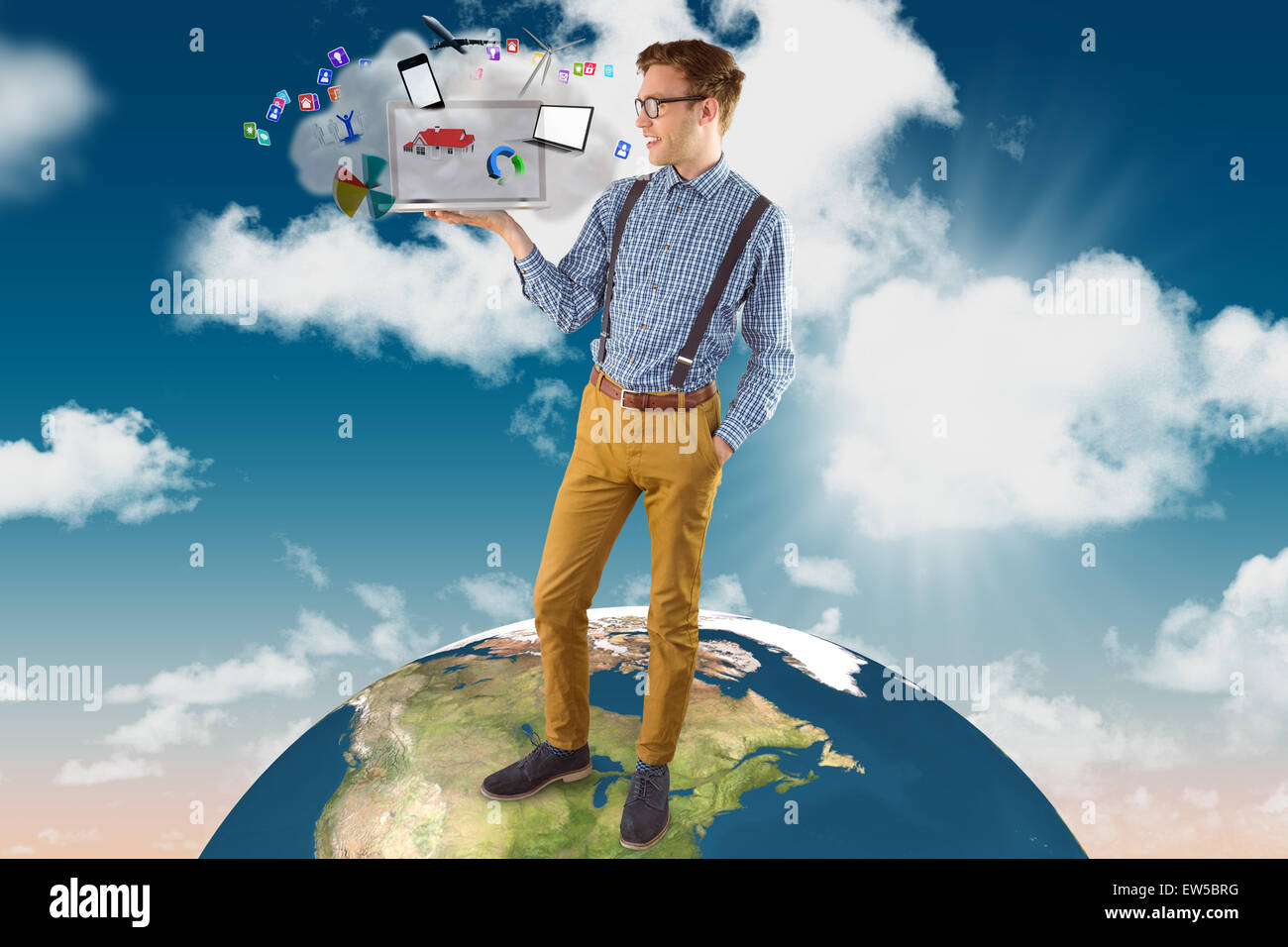 Composite image of geeky businessman showing his laptop - Stock Image