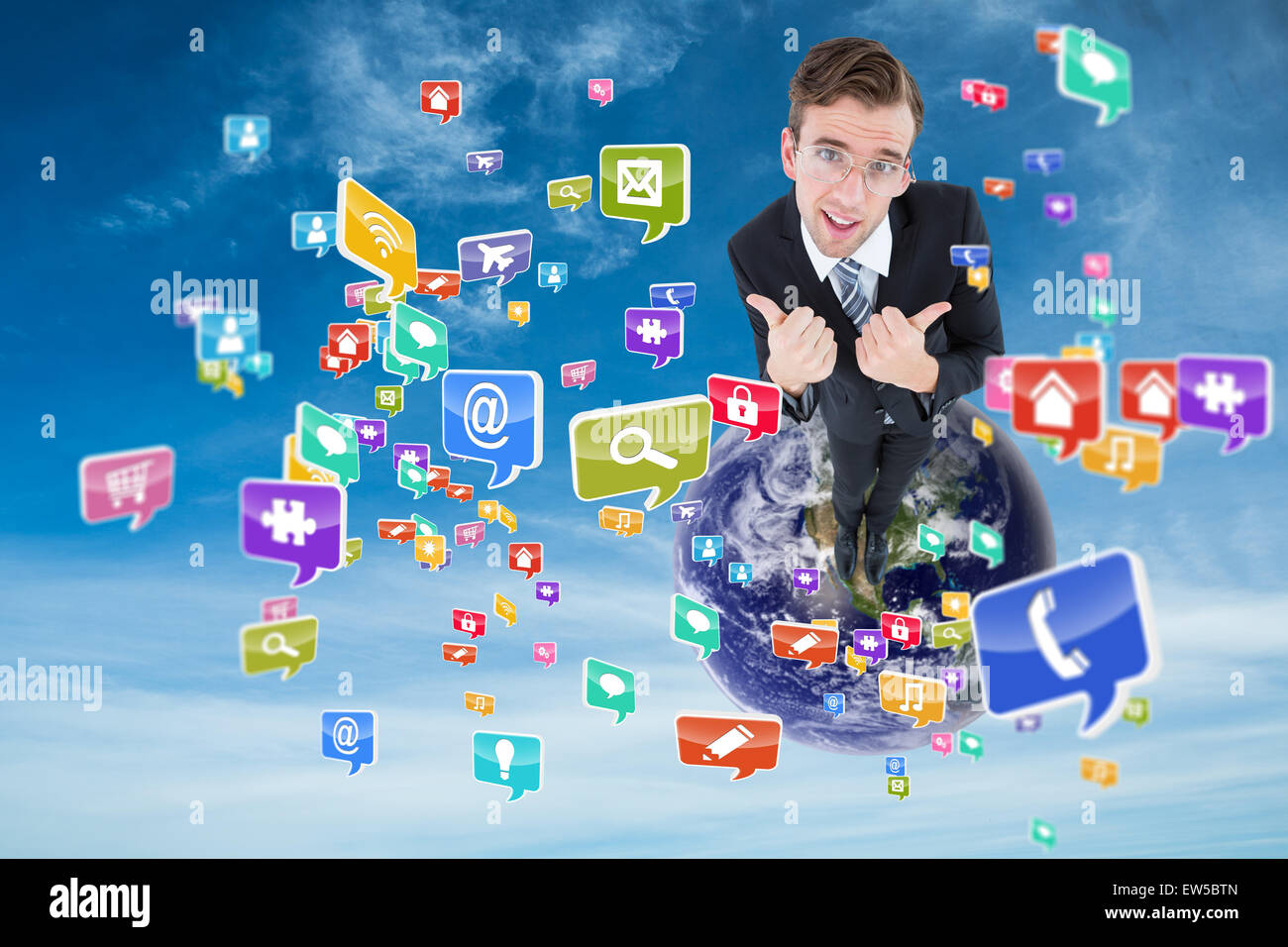 Composite image of geeky businessman with thumbs up - Stock Image