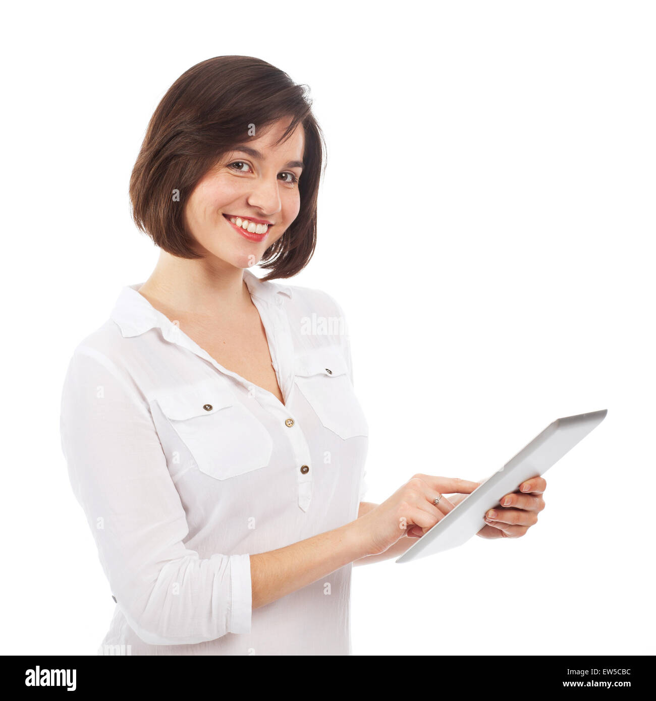 Young smiling woman using a touchpad, isolated on white - Stock Image