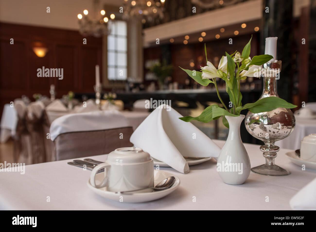 table setting in an upmarket hotel restaurant - Stock Image