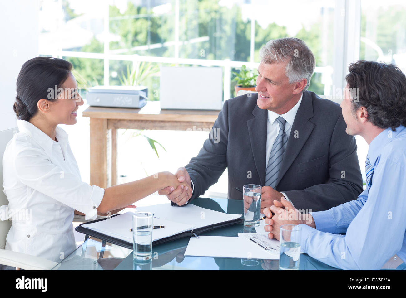Business people reaching an agreement - Stock Image