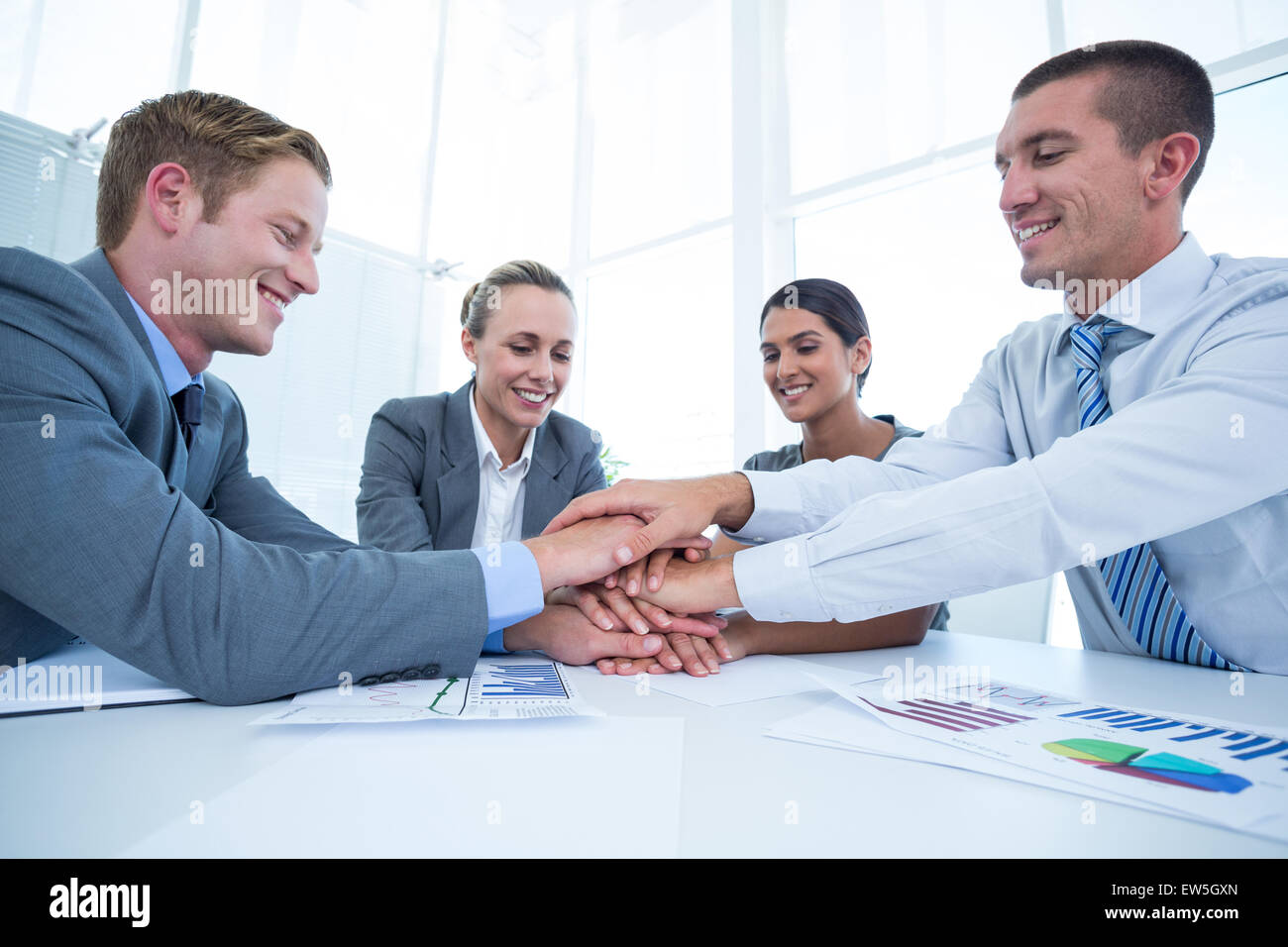 Business team celebrating a good job - Stock Image