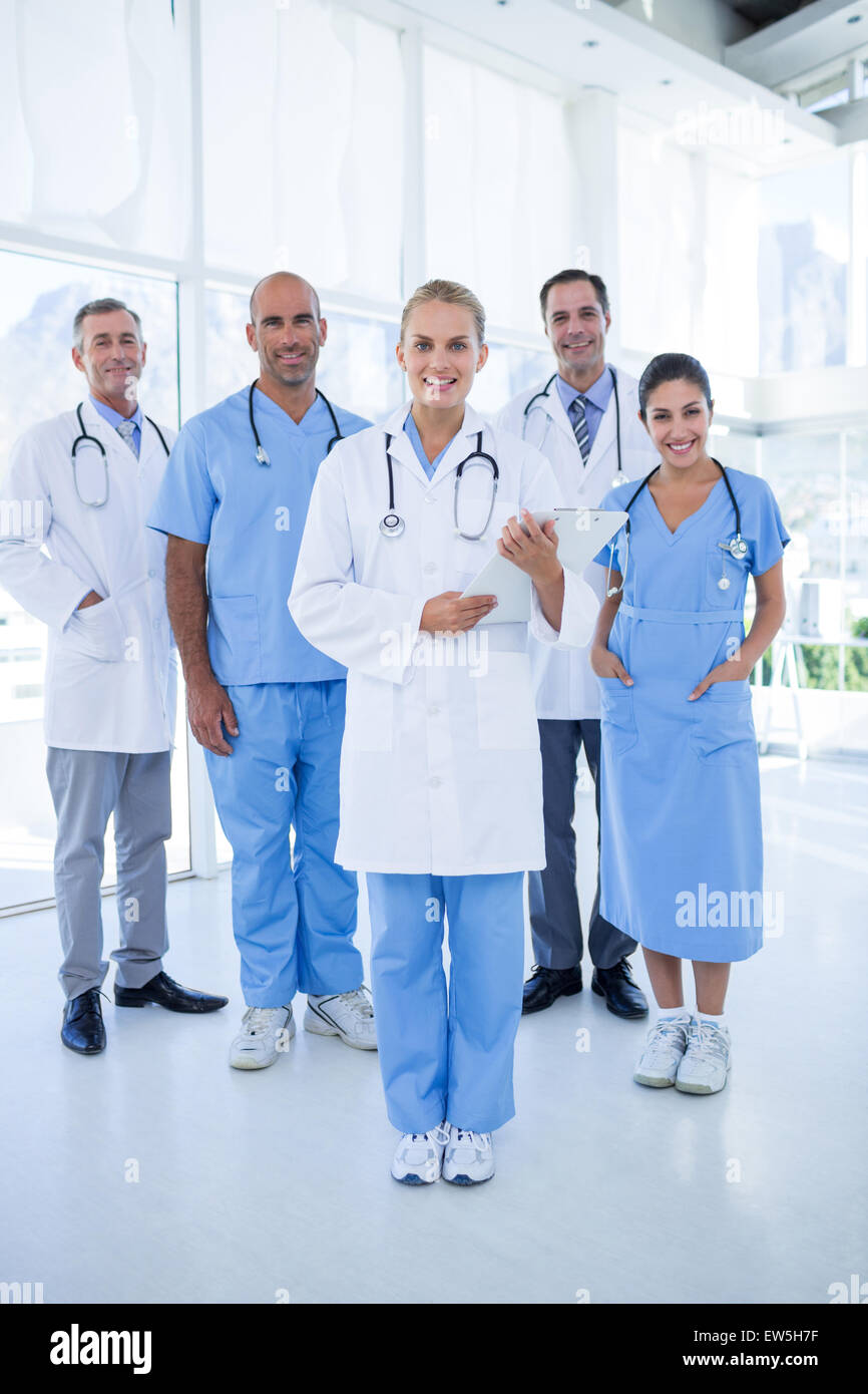 Team of smiling doctors looking at camera - Stock Image