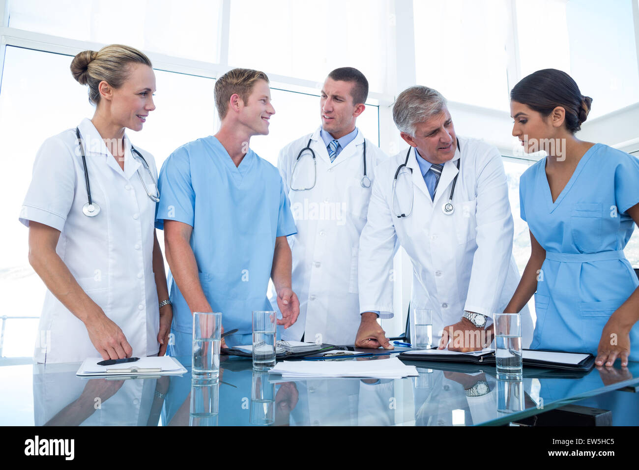 Team of doctors looking at their diaries - Stock Image