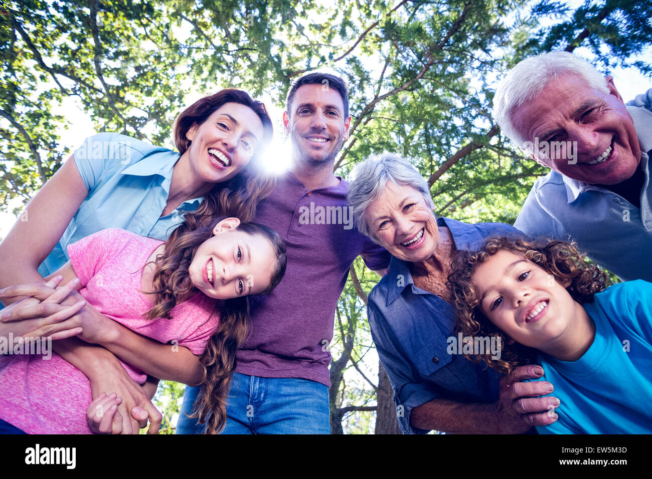 Happy family smiling at the camera - Stock Image