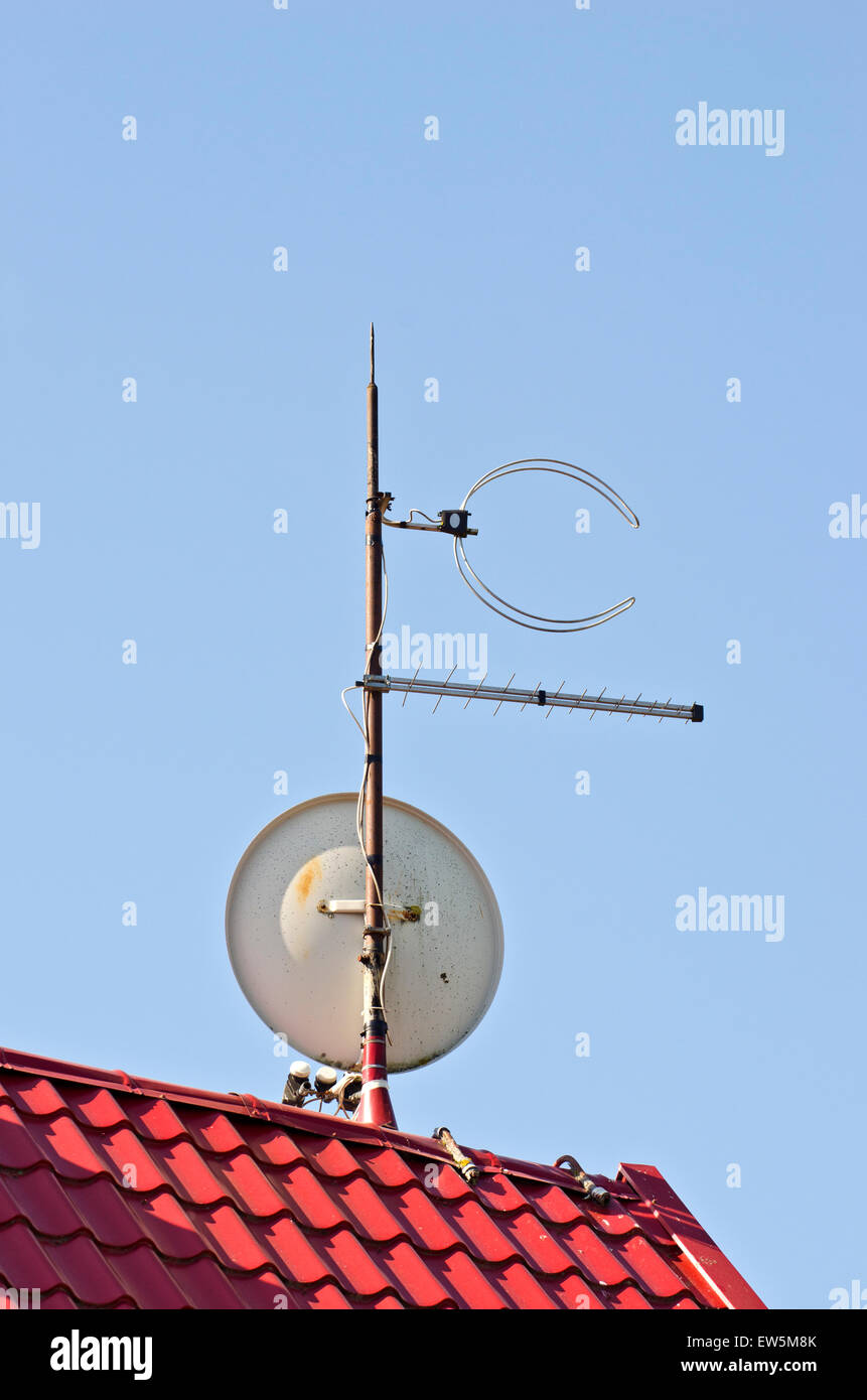 satelite dish antenna on new tiled red  roof Stock Photo