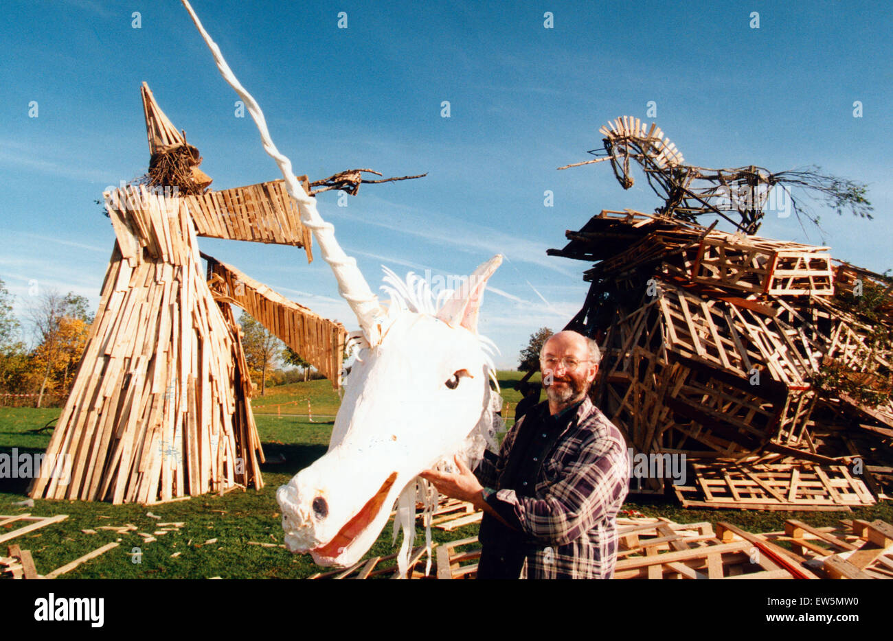 Sculptor, Phil Bews with his bonfire sculptures of a wizard and a unicorn. Birchwood forest park, Warrington,  3rd - Stock Image